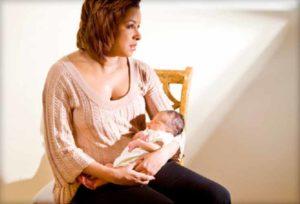 What is postpartum psychosis?