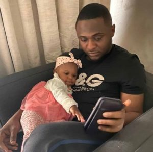 Ubi Franklin pictured with his 4th child, Ariella